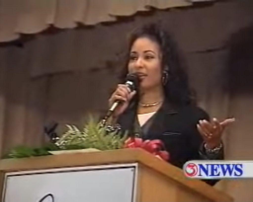 CORPUS CHRISTI, TX — Selena speaks to Cunningham Middle School students in Nov. 1994. Photo Credit: KIII TV / YouTube.