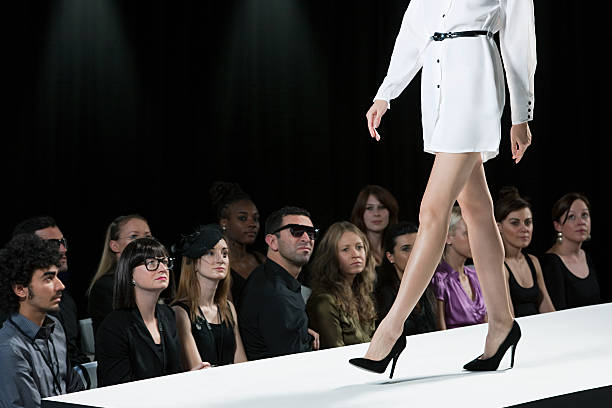 Body shaming in the fashion and entertainment industry: A runway model is shown on a catwalk. Photo Credit: Stock.
